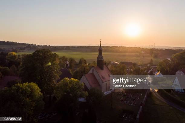 Aerial view to the protestant church during sunset on October 16 2018 in Arnsdorf Germany