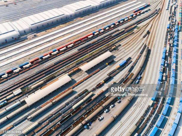 aerial view train and railway tracks in container cargo warehouse for transportation, import export or logistics background. - bahngleis stock-fotos und bilder