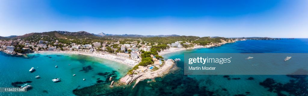 Aerial View View Of Peguera With Hotels And Sandy Beach