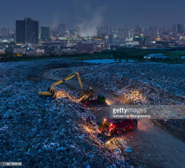 aerial view waste management with cityscape background at dusk for environment reservation. - garbage dump stock pictures, royalty-free photos & images