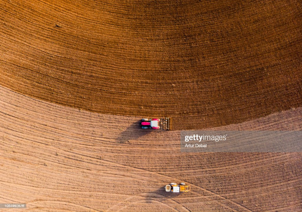 Aerial view with drone of tractor plowing the land in the countryside. : Stock Photo