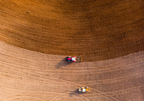 Aerial view with drone of tractor plowing the land in the countryside. - gettyimageskorea