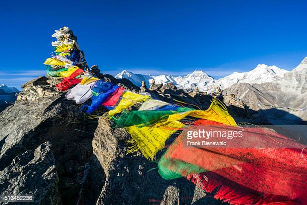 Aerial view with tbetean prayer flags from Gokyo Ri snow covered mountains in the distance