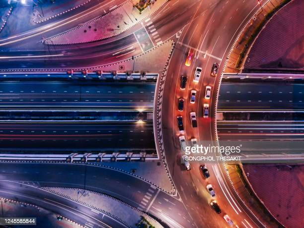 aerial view/circle roads and traffic at night - multiple lane highway stock pictures, royalty-free photos & images