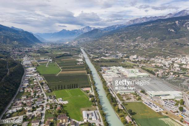 aerial viewf of the rhone river and valley near the town of sierre, valais, switzerland - valais canton stock pictures, royalty-free photos & images
