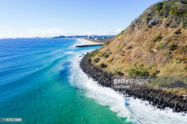 aerial viewpoint of burleigh headland gold coast australia with the ocean and people surfing - gold coast queensland stock pictures, royalty-free photos & images