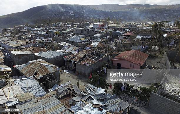 Aerial views of Jeremie 188 km west of PortauPrince on October 10 following the passage of Hurricane Matthew Haiti faces a humanitarian crisis that...