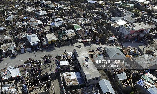 TOPSHOT Aerial views of Jeremie 188 km west of PortauPrince on October 10 following the passage of Hurricane Matthew Haiti faces a humanitarian...