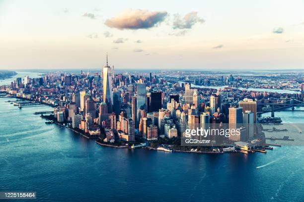 aerial views of manhattan island, new york - cities under covid-19 series - new york city stock pictures, royalty-free photos & images
