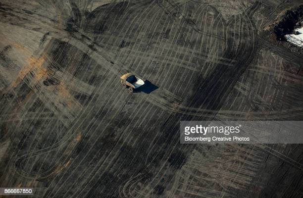 aerial views of oil sands operations - oil sands stock pictures, royalty-free photos & images