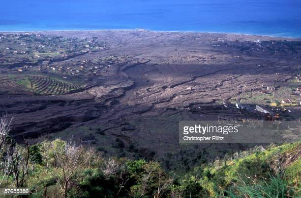 Aerial views of the slopes of the Soufriere Hills showing the destruction and complete loss of the capital of Monserrat Plymouth and St Patrick's...