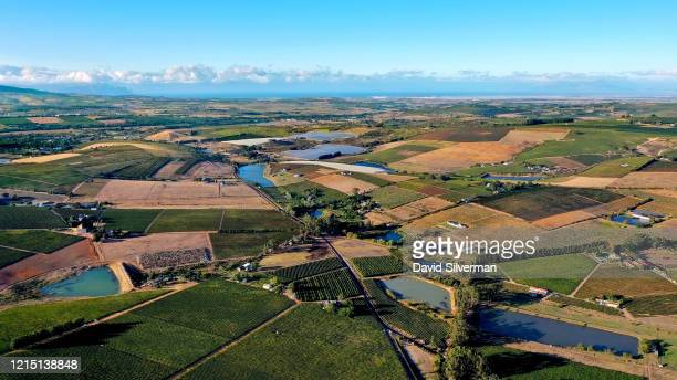 Aerial views of the vineyards in the Devon Valley and the surrounding farms looking towards False Bay on the Atlantic coastline on February 28 2020...