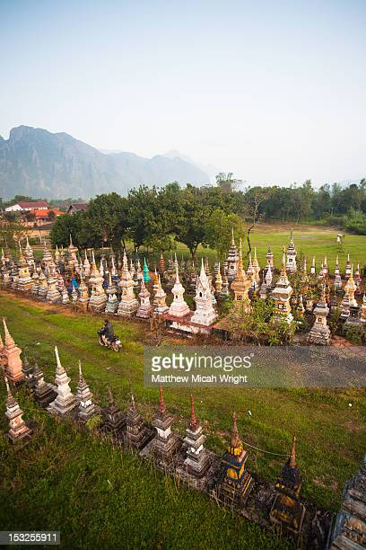 Aerial views over a graveyard in a city.