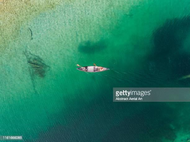 aerial views over a kayak on lake eibsee, bavaria, germany - majestätisch stock-fotos und bilder