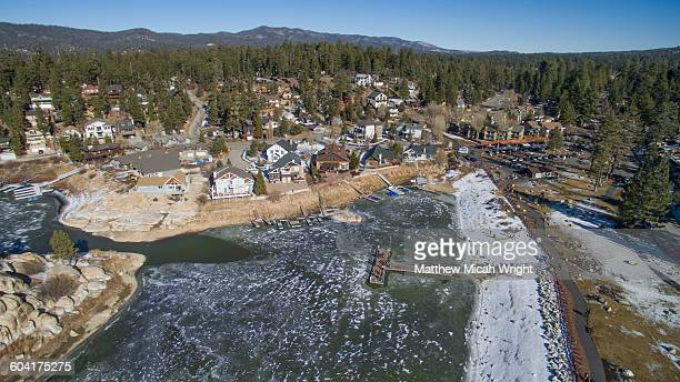 aerial views over big bear lake, california. - big bear lake stock pictures, royalty-free photos & images