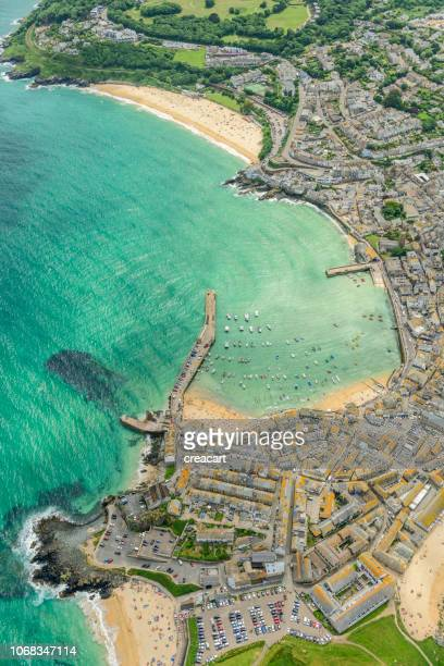 aerial views over st. ives, cornwall, england on a bright june day. - st. ives cornwall stock pictures, royalty-free photos & images