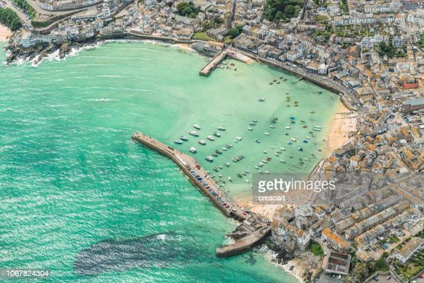aerial views over st. ives, cornwall on a sunny june day. - st. ives cornwall stock pictures, royalty-free photos & images