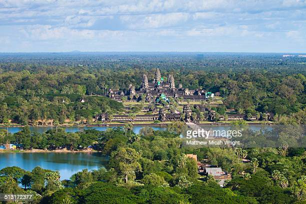aerial views over the ruins of angkor wat - angkor wat stock pictures, royalty-free photos & images