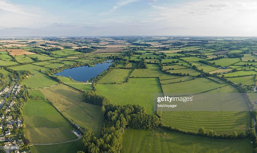 Aerial vista over farm and village : Stock Photo