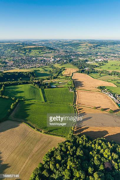 aerial vista over patchwork landscape farm fields country town - overhemd en stropdas stock pictures, royalty-free photos & images