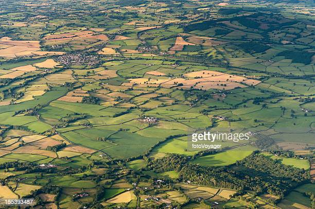 Aerial vista over patchwork summer landscape