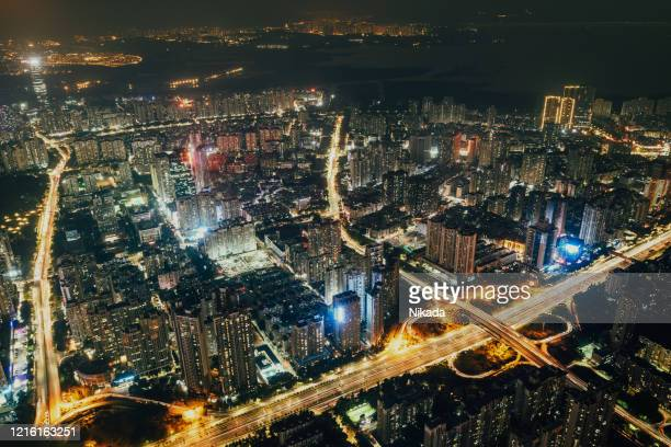 aerial viw of shenzhen, china at night - guangdong province stock pictures, royalty-free photos & images