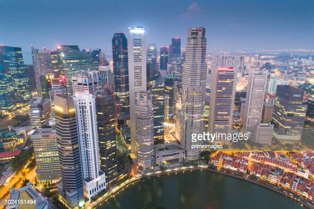 aerial wide cityscape view of skyline in singapore downtown cbd central - merlion park stock photos and pictures