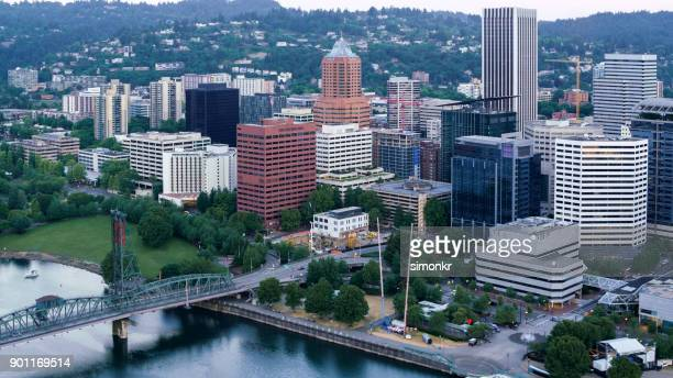 aerial willamette river and downtown portland early in morning - willamette river stock photos and pictures
