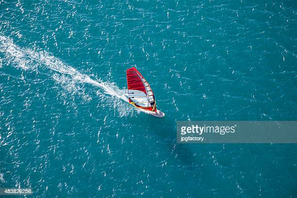 aerial wind surfer on action - windsurfing stock pictures, royalty-free photos & images