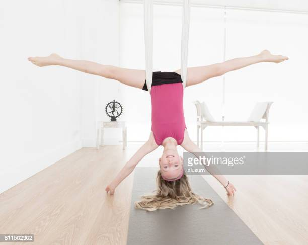 aerial yoga class for children - acrobatic activity stock pictures, royalty-free photos & images