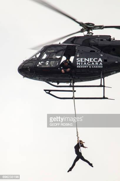 Aerialist Erendira Wallenda hangs beneath a helicopter during a stunt over the Horseshoe Falls at Niagara Falls New York June 15 2017 / AFP PHOTO /...
