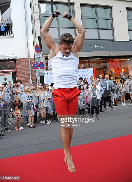 Aerialist Thomas Seitel performs at the Ben Weide Performance Party during the MercedesBenz Fashion Week Berlin Spring/Summer 2016 at Ben Weide...