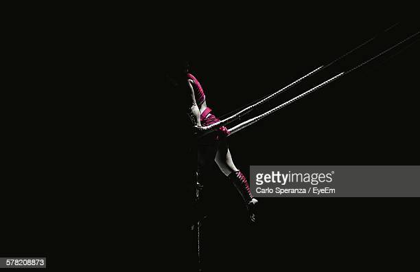Aerialist Woman Performing On Pole In Circus
