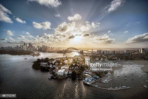 aeriall view of sydney harbour at sunset - sydney stock pictures, royalty-free photos & images