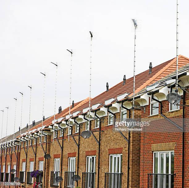 TV aerials and satellite dishes on rooftops