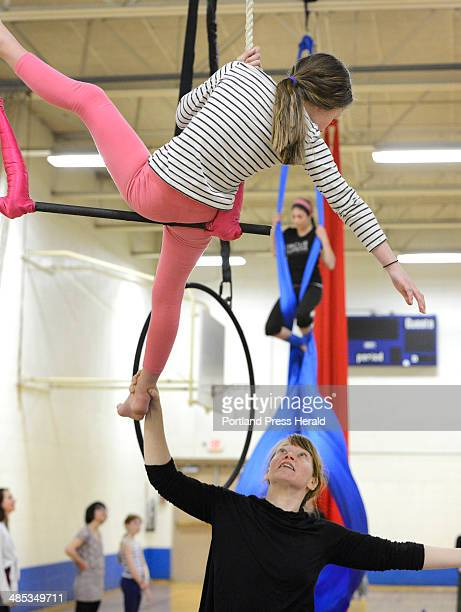 Aerials coach Jeanette Fertig works with 8 yr old Norah Peabey from Portland on the trapeze as Circus Atlantic hosted a open house at Reiche School...