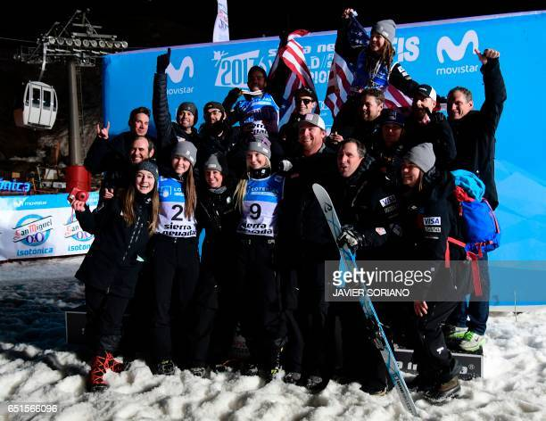 Aerials men and woemen's World Champions 2017 US skier Jonathon Lillis and US skier Ashley Caldwell pose with US team after the podium ceremonies of...