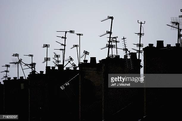 Aerials populate the rooftops in Castlemilk on September 18, 2006 in Glasgow, Scotland. The United Kingdom's switch to digital television could be as...