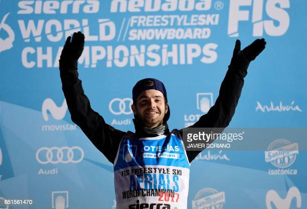 Aerials World Champion 2017 US skier Jonathon Lillis celebrates his victory on the podium of the men's aerials final in the FIS Snowboard and...