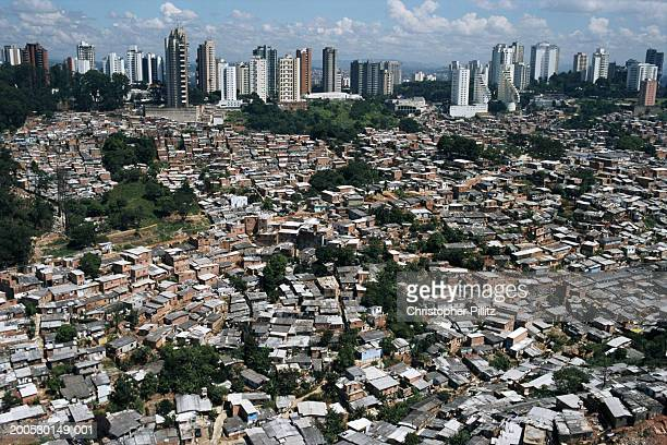 Aeriel view of a large favela with luxury apartment blocks in Sao Paulo city, Brazil