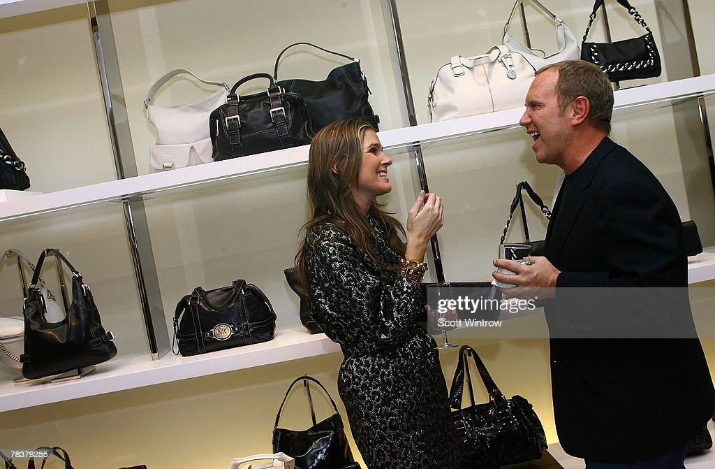 06f68437b5f2b Aerin Lauder and designer Michael Kors attend the Michael Kors store ...