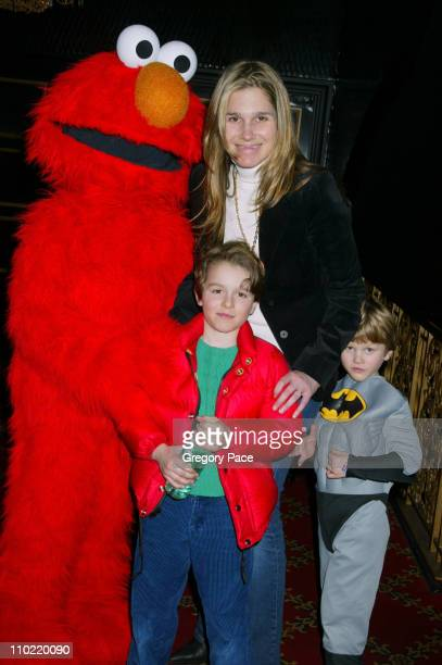 Aerin Lauder with her sons Jack and Will pose with Elmo