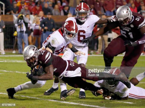 Aeris Williams of the Mississippi State Bulldogs dives in for the touchdown as Keith Holcombe and Rashaan Evans of the Alabama Crimson Tide try to...