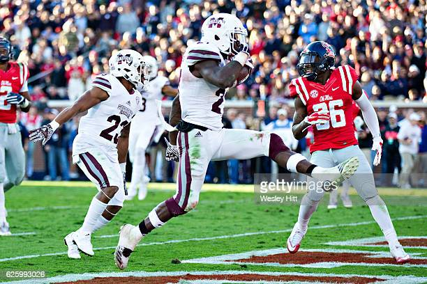Aeris Williams of the Mississippi State Bulldogs high steps into the end zone for a touchdown in the first half of a game against the Mississippi...