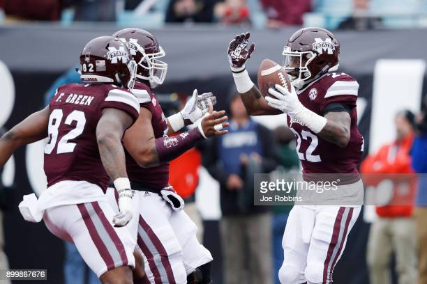 Aeris Williams of the Mississippi State Bulldogs reacts after rushing for a fiveyard touchdown in the first quarter of the TaxSlayer Bowl against the...