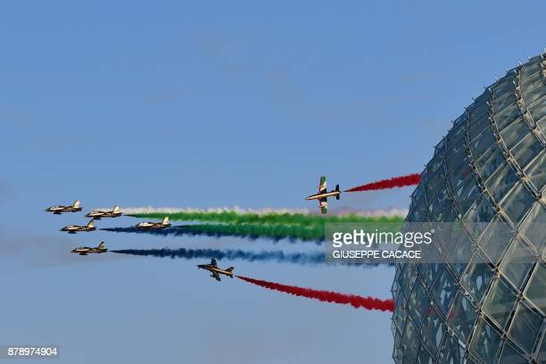 Aermacchi MB339 jets from UAE's AlFursan display team perform before the qualifying session ahead of the Abu Dhabi Formula One Grand Prix at the Yas...