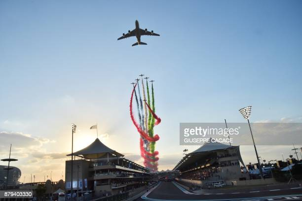 TOPSHOT Aermacchi MB339 jets from UAE's AlFursan display team perform with an Etihad Airways' Airbus A380 before the start of the Abu Dhabi Formula...