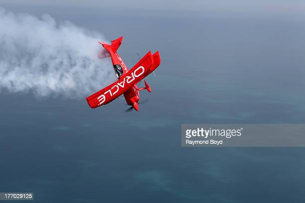 Aerobatic pilot Sean Tucker of Team Oracle practices stunts in his Oracle Challenger III biplane over Lake Michigan in Chicago Illinois on AUGUST