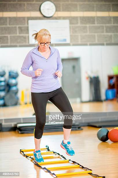 aerobic fitness class - circuit training stock photos and pictures