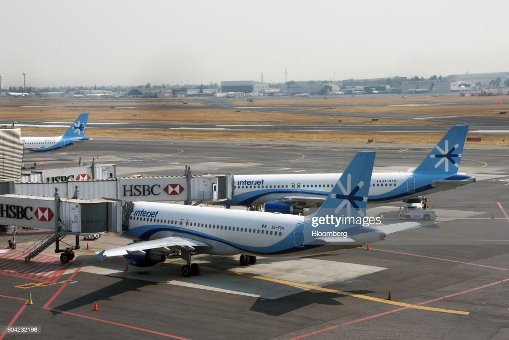 ABC Aerolineas SA de CV (Interjet) airplanes sit on the tarmac at Benito Juarez International Airport (MEX) in Mexico City, Mexico, on Friday, Jan. 5, 2018. Interjet made a splash as Mexico's first airline for the budget-conscious flyer when it was founded in 2005. But in the years that followed, the carrier hit turbulent skies, causing the company's overall market share to stagnate while Competitor Volaris captured more passengers. Photographer: Lujan Agusti/Bloomberg via Getty Images